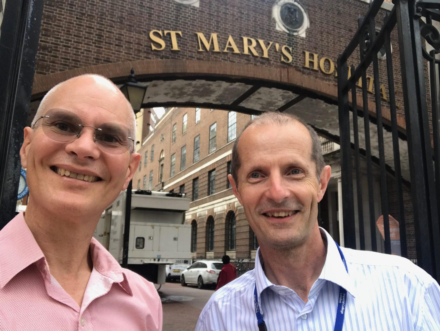Stephen Kent and Robin Shattock standing outside the entrance to St Mary's hospital
