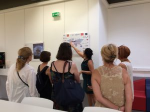 people looking at EAVI2020 photos at INSERM